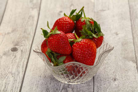 Ripe fresh Strawberry heap in the bowl