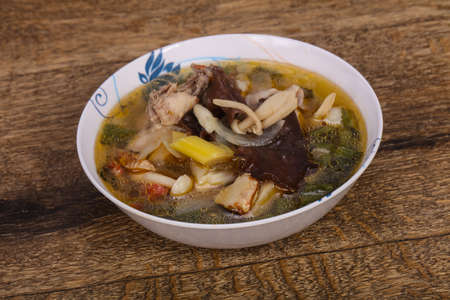 Thai style soup with meat, vegetables and mushrooms 스톡 콘텐츠