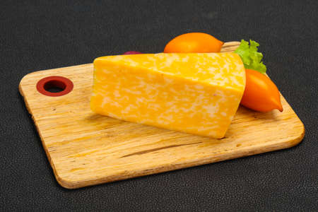 Marble cheese  triangle over wooden background