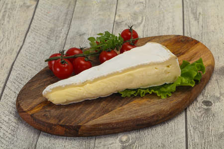Brie cheese triangle served salad leaves Stock Photo