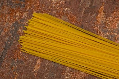 Dry raw spaghetti ready for bowling