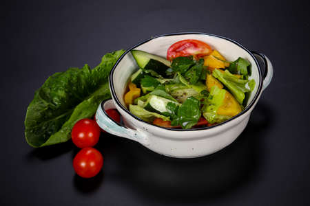 Seasonal vegetarian Vegetable salad with herbs and olive oil