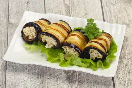 Stuffed eggplant with cheese and herbs served salad