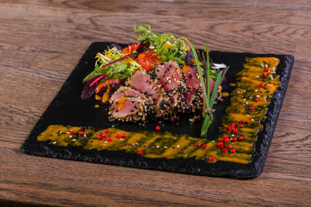 Tuna carpaccio with sauce and spices Stock fotó