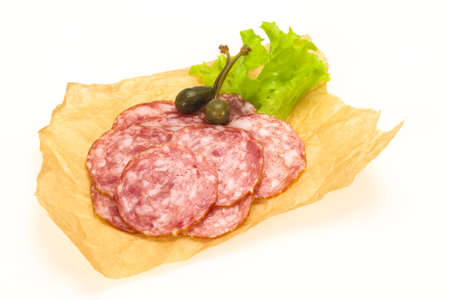 Spanish Salchichon sausage with salad leaves
