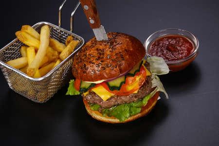 Hot tasty and juicy burger served fry potato Stock fotó