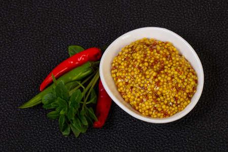 Traditional dijon mustard served basil leaves