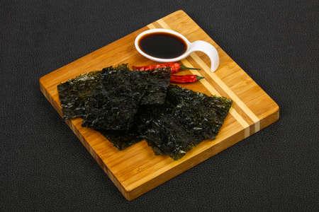 Tasty Nori chips with soya sauce Reklamní fotografie