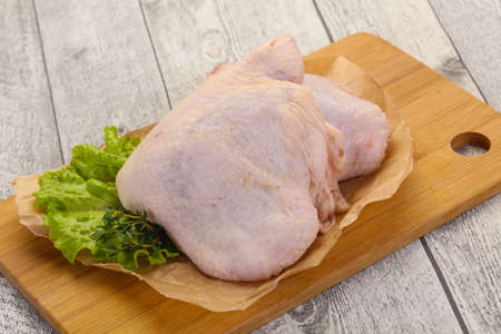 Raw chicken hip ready for cooking Stok Fotoğraf - 129323729