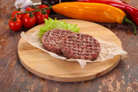 Raw burger cutlet ready for grill