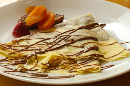 Pancake with chocolate and dried fruits 스톡 콘텐츠