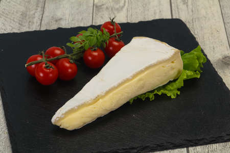 Brie cheese triangle served salad leaves
