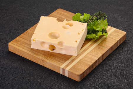 Maasdam cheese brick with thyme branch Stock fotó