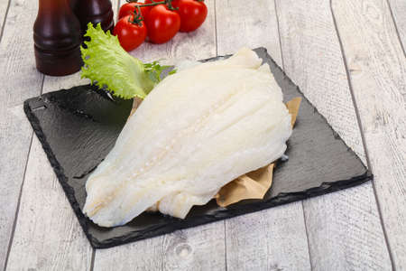 Raw halibut fillet ready for cooking Stock Photo