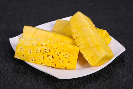 Sliced sweet ripe tasty pineapple in the plate