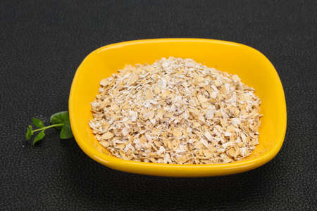 Raw oats in the bowl for breakfast
