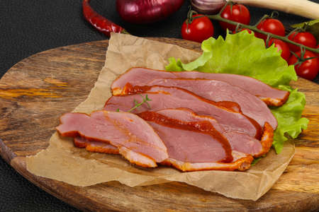 Sliced smoked duck breast served salad leaf