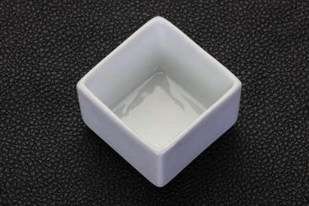 White porcelain bowl over black background