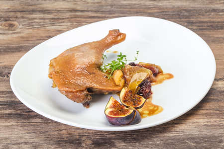 Roasted. duck. leg with plum, fig and apple 스톡 콘텐츠