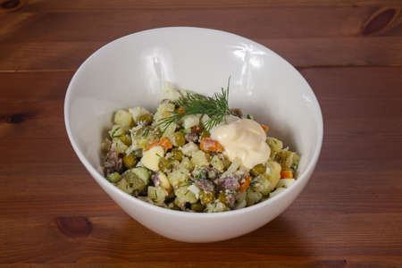 Traditional Russian salad with meat and green peas 스톡 콘텐츠
