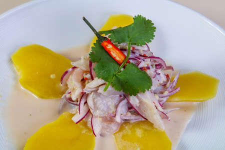 Ceviche with pollock and onion served potato