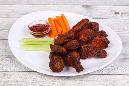 Chicken wings bbq with celery and carrot sticks 스톡 콘텐츠