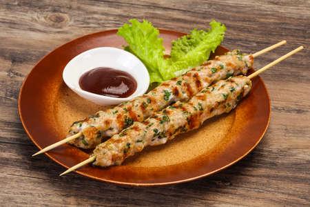 Minced pork skewer kebab with bbq sauce