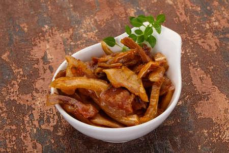 Pork ear snack in the bowl Reklamní fotografie