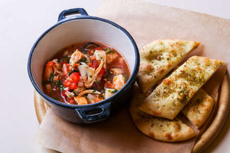 Seafood suop with bread and spices Stockfoto