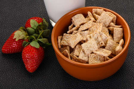 Wheat flakes for breakfast with milk and strawberry Фото со стока