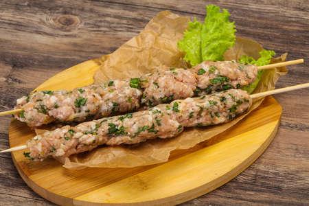 Raw pork skewer kebab ready for grill