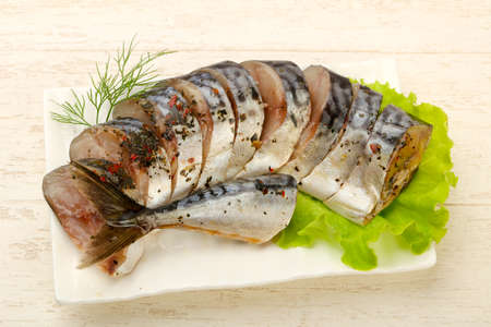 Pickled Scomber with hetbs and spices served salad leaves Stok Fotoğraf - 129760240