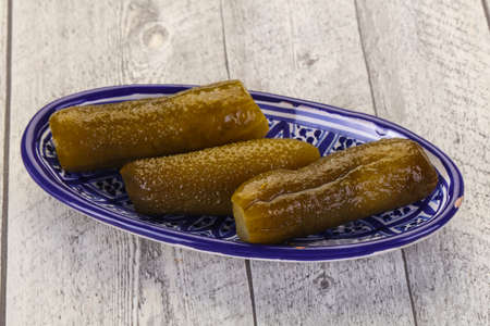 Pickled homemade cucumbers in the bowl Stock Photo