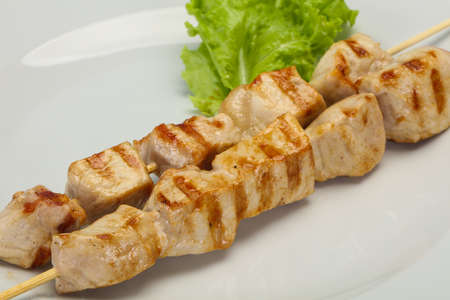 Grilled pork skewer served salad leaves Фото со стока - 129760589