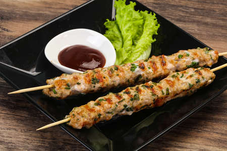 Minced pork skewer kebab with bbq sauce Фото со стока - 129761114