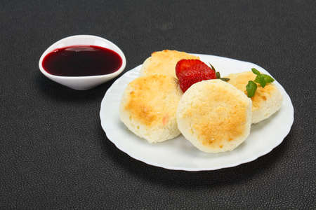 Curd pancakes with jam and stravberry served mint