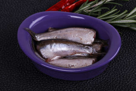 Anchovy fish snack in the bowl served salad leaves and rosemary Stok Fotoğraf - 130073309