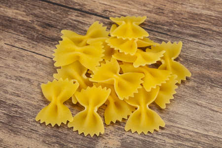 Raw dry farfalle pasta ready for cooking