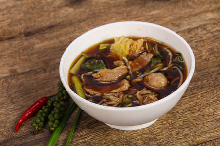 Thai style soup with meat, vegetables and mushrooms Imagens