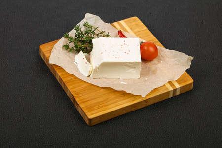 Traditional Feta Cheese served thyme Фото со стока - 129823788