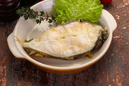 Baked wolffish steak with salad leaves Фото со стока - 129823822