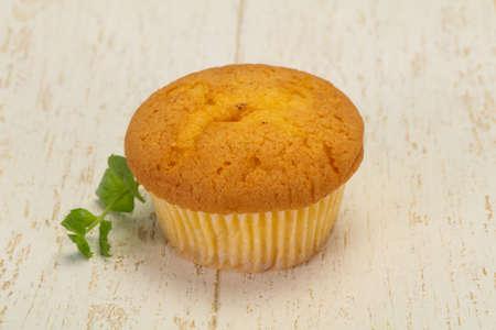 Sweet tasty muffin served mint leaf