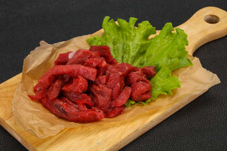 Raw beef meat sliced ready for cooking Фото со стока - 129823878