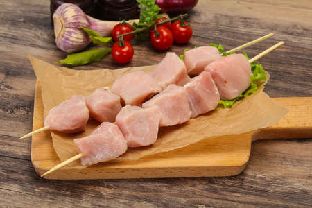 Raw pork meat skewer ready for grill Фото со стока - 129823956