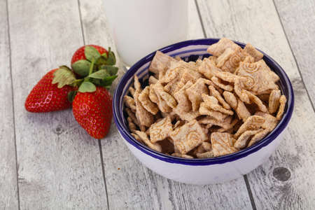 Wheat flakes for breakfast with milk and strawberry Stock fotó