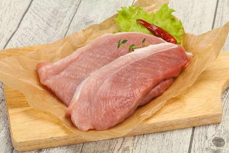 Juicy raw pork steak meat ready for grill
