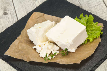 Greek traditional Feta soft cheese in the plate 写真素材 - 129848874
