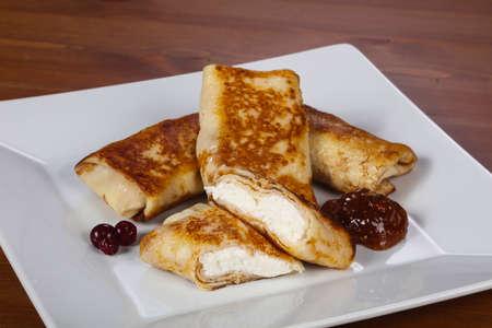 Pancakes stuffed curd with fruit jam 写真素材 - 129848923