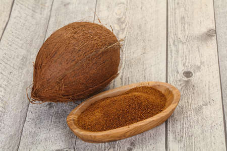 Coconut brown sugar in the bowl over wooden background Stockfoto