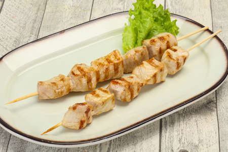 Grilled pork skewer served salad leaves